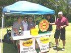 Midas staff sponsors & volunteer at Midas 13th Hole